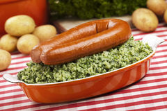 Dutch food: kale with smoked sausage or 'Boerenkool met worst' Royalty Free Stock Photography