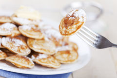 Dutch food: 'Poffertjes' or little pancakes Stock Photo