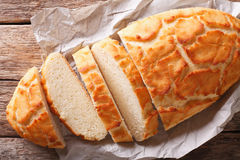 Dutch food: Tiger bread sliced close-up. Horizontal top view. Dutch food: Tiger bread sliced close-up on the table. Horizontal view from above stock photo