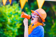 Dutch football fan, cute boy cheering Royalty Free Stock Photos