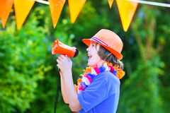 Dutch football fan, little happy boy cheering Stock Photo