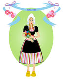 Dutch girl. With traditional outfit and symbols of holland Stock Photography