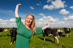 Dutch girl happy in field with cows Royalty Free Stock Image