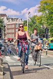 Dutch girl on her Bicycle, Amsterdam, netherlands. Stock Images