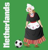 Dutch girl in national costume with soccer ball. Netherlands as a girl in traditional dutch folk costume with soccer ball Stock Photo