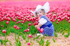 Dutch girl in tulip field in Holland Stock Photo
