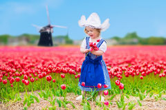 Dutch girl in tulip field in Holland Royalty Free Stock Images