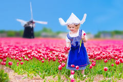 Dutch girl in tulip field in Holland Royalty Free Stock Image