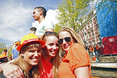 Dutch girls in orange celebrating queensday Royalty Free Stock Images