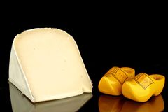 Dutch goat cheese with wooden clogs Stock Photos