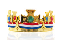 Dutch golden crown for the king. Dutch golden crown with flag colors for the king isolated over white background Royalty Free Stock Photography