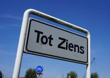 Dutch greeting Tot Ziens on a sign. A sign with the Dutch greeting Tot Ziens English: until next time stock images