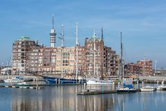 Dutch Harbor of Lelystad with communication Tower and apartment building. Lelystad, The Netherlands - February 23, 2019: Harbor with communication Tower and stock photo