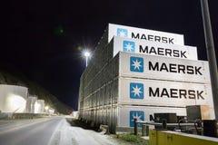 Pile of shipping containers outdoors at night in Unilaska, Alask. Dutch Harbor, Unalaska, Alaska, USA - August 15th, 2017: Pile of Shipping Containers of Maersk stock photos