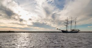 Dutch harbor of Urk with sunset and sailing ship Stock Images