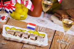 Dutch herring ('haring') with onions and pickles Stock Photos