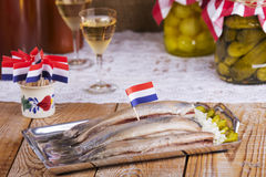 Dutch herring ('haring') with onions and pickles Stock Image