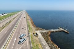 Dutch highway at the afsluitdijk between Friesland and Noord-Holland. Dutch highway at the afsluitdijk. The dike is the connection between Friesland and Noord Royalty Free Stock Images