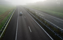 Dutch highway on a misty morning Stock Photos