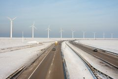 Dutch highway in wintertime with wind turbines Royalty Free Stock Images