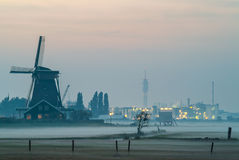 Dutch historic windmill with industry buildings Royalty Free Stock Image