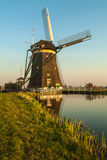 Dutch historic windmill during sunset Stock Images
