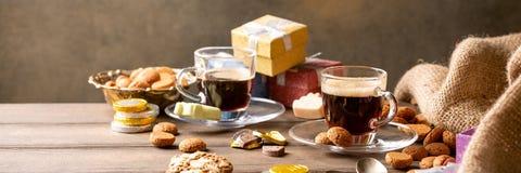 Dutch holiday Sinterklaas festive breakfast. St. Nicolas day concept. Dutch holiday Sinterklaas, festive breakfast with coffee, kruidnoten, traditional sweets stock photography