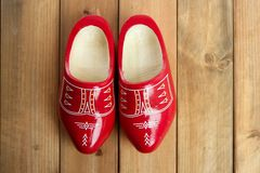 Dutch Holland red wooden shoes on wood. Background Royalty Free Stock Photo