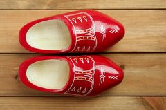 Dutch Holland red wooden shoes on wood Stock Photos