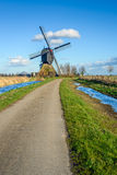 Dutch hollow post mill from 1795 on a sunny day Stock Photo