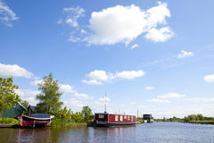 Dutch houseboats on little river in The Netherlands Royalty Free Stock Photos