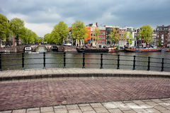 Dutch Houses by the Amstel River in Amsterdam Stock Photos