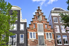 Dutch houses at a canal in Amsterdam Royalty Free Stock Photos