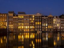 Dutch houses on the Damrak in Amsterdam. Royalty Free Stock Photos
