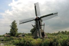 Dutch landscape. Little mill and old houses Royalty Free Stock Photography