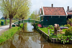 Dutch  landscape . Typical Dutch landscape - houses along the canal Royalty Free Stock Images