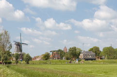 Dutch landscape. With windmill near Garnwerd in Groningen, The Netherlands Royalty Free Stock Photography