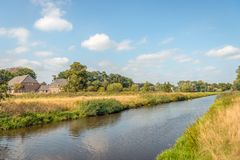 Colorful summer landscape along a river. Dutch landscape along the bank of the river Mark near the city of Breda, Noord-Brabant. It is a sunny day in the summer stock photo