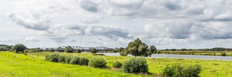Dutch landscape with bridge. Landscape with bridge across the river between Den Bosch and Hedel in the Netherlands Stock Images
