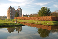 Dutch landscape- Castle Croy - Laarbeek. Dutch landscape with castle Croy - Laarbeek - reflecting in a canal - Noord-Brabant - Netherlands stock images