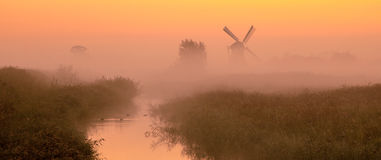 Dutch landscape with historic windmill Royalty Free Stock Photo