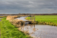 Dutch Landscape with water and bridges Royalty Free Stock Photography
