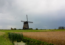 Dutch landscape with windmill Royalty Free Stock Images
