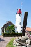Dutch lighthouse with a big anchor in front of it Royalty Free Stock Photos