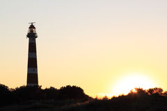 Dutch lighthouse Bornrif in Ameland dunes at sunset Royalty Free Stock Photos