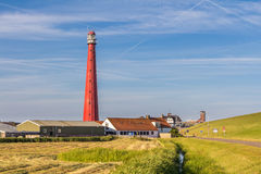 Dutch Lighthouse in Den Helder. Lighthouse at the coast of Den Helder in Northern Holland royalty free stock photo