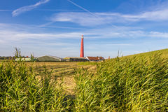 Dutch Lighthouse in Den Helder. Lighthouse at the coast of Den Helder in Northern Holland stock photo