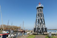 Dutch lighthouse at entrance of harbor Enkhuizen, royalty free stock photo