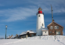 Dutch lighthouse in wintertime. Dutch lighthouse of fishery village Urk in wintertime royalty free stock images