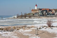 Dutch lighthouse in wintertime near frozen sea Royalty Free Stock Images